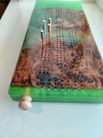 Cotton Wood Burl cribbage board with bright green epoxy