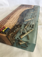 Custom Cribbage board with spent ammunition casings